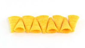 Crunchy corn snacks on a white background Royalty Free Stock Photography