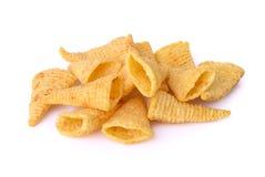 Crunchy corn snacks on a white background Stock Photos