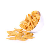 Crunchy corn snacks in white bowl on a white background Stock Photography