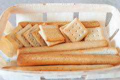 Crunchy crackers sticks in wicker box Stock Photos