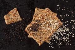 Crispy flatbread crackers with sesame and hemp seeds. Stock Photos