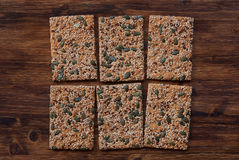 Crunchy crispbread on a wooden background. Healthy snack: cereal crunchy multigrain cereal flax seed pumpkin, coriander, sesame, sunflower seeds protein bread Stock Photo