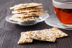 Crunchy crispbread on a wooden background. Healthy snack: cereal crunchy multigrain cereal flax seed ,sesame, sunflower seeds. Protein bread bar royalty free stock images