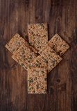 Сrunchy crispbread on a table. Crunchy crispbread on a wooden table. Healthy snack: cereal crunchy multigrain cereal flax seed pumpkin, coriander, sesame Royalty Free Stock Image