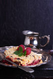 Crunchy crumble with raspberry. Decorated mint leaf royalty free stock photos