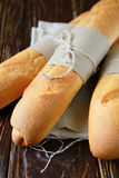 Crunchy and flavorful baguettes on the wooden table Stock Photos