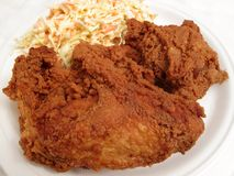 Crunchy Fried Chicken & Slaw. Photo fried chicken breast and thigh served with cole slaw.  This is traditional American junk food Royalty Free Stock Photos