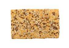 Crunchy gluten free crispbread with various seeds isolated. Crunchy gluten free crispbread with various seeds top view. Whole grain wheat crisp bread or cracker royalty free stock photos