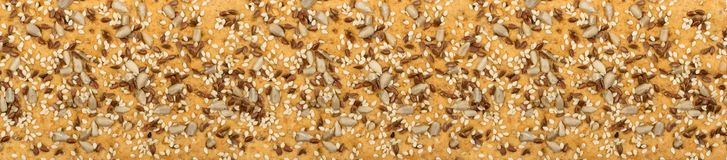 Crunchy gluten free crispbread with various seeds isolated. Crunchy gluten free crispbread with various seeds top view. Whole grain wheat crisp bread or cracker royalty free stock photography