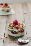 Crunchy Granola with Natural Yogurt and Fresh Raspberries on Wooden Table Royalty Free Stock Photography