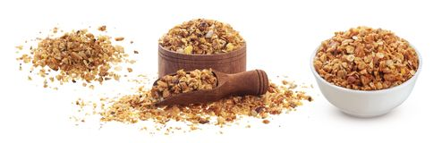 Crunchy granola with nuts isolated on white background with clipping path. Crunchy granola isolated on white background with clipping path, muesli pile with nuts royalty free stock image