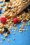 Crunchy granola on wooden spoon Royalty Free Stock Photo