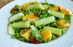 Crunchy green salad with pecans and sweet lime Stock Photography