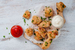 Crunchy nuggets with two sauces Royalty Free Stock Image