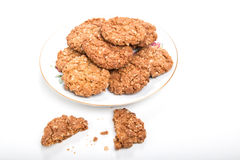 Crunchy oat biscuits/cookies on a white plate Royalty Free Stock Photography