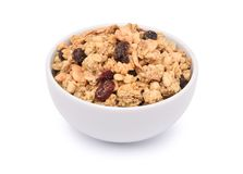 Crunchy oat granola cereal with dried fruits in white bowl royalty free stock image