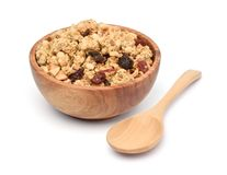 Crunchy oat granola cereal with dried fruits in wooden bowl stock image