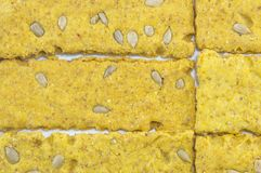 Crunchy oat thins with sunflower  forming pattern on white Royalty Free Stock Images