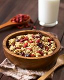 Crunchy Oatmeal Cereal with Almond and Dried Berries. Crunchy oatmeal cereal with almond and dried goji berries and cranberries in wooden bowl, photographed with royalty free stock photography