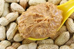 Crunchy peanut butter on peanuts Stock Image