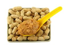 Crunchy peanut butter on peanuts Stock Photo