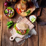 Crunchy pita with grilled gyros meat. Various vegetables and gar royalty free stock images