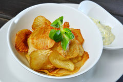 Crunchy potato crisps in bowl. Close up of crunchy potato crisps in bowl Stock Image