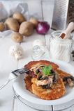 Crunchy potato pancakes with mushrooms Royalty Free Stock Photo