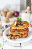 Crunchy potato pancakes with mushrooms Stock Photo