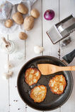 Crunchy potato pancakes with mushrooms Royalty Free Stock Image