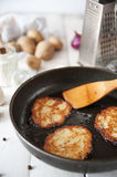 Crunchy potato pancakes with mushrooms Royalty Free Stock Images