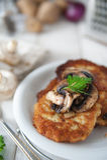 Crunchy potato pancakes with mushrooms Stock Photography