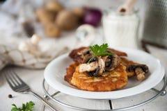 Crunchy potato pancakes with mushrooms Royalty Free Stock Photography