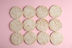 Crunchy rice cakes on color background. Top view royalty free stock image