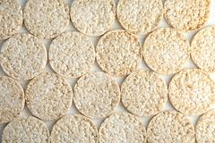 Crunchy rice cakes on white wooden background. Top view stock photo