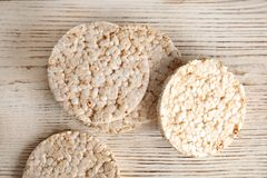 Crunchy rice cakes on wooden background. Top view royalty free stock images