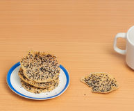 Crunchy rice cracker strew with black and white sesame Royalty Free Stock Photography