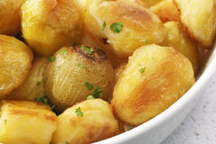 Crunchy Roast Potatoes and Onions Royalty Free Stock Image