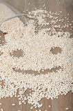 Crunchy in a shape of smily face. Crunchy flakes in a shape of a smily face scattered on the wooden table royalty free stock images