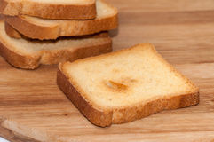 Crunchy toast bread on the wooden board Stock Photo