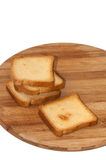 Crunchy toast bread on the wooden board Stock Photos