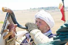 Crusader blows a horn Royalty Free Stock Photo