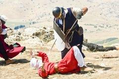 Crusader kills a Saracene Royalty Free Stock Photos