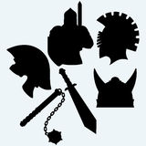 Crusader metallic knight's helmet, sword and mace. On blue background. Vector silhouettes Stock Photos