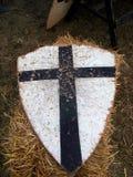 Crusader shield. Crusader medieval shield on straw Stock Photo