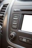Cruscotto dell'automobile con lo schermo bianco isolato dell'affissione a cristalli liquidi Fotografie Stock Libere da Diritti