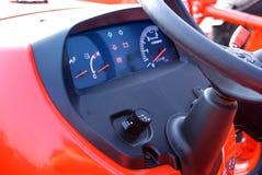 Cruscotto rosso del trattore Fotografie Stock
