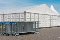 Crush barriers near a big marquee. For a party royalty free stock photography