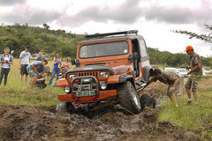 Crush Beige Jeep Wrangler Off-Roader V8. BAFOKENG - MARCH 8: Crush Beige Jeep Wrangler Off-Roader V8 crossing water obstacle without axil strap at Leroleng 4x4 stock photography