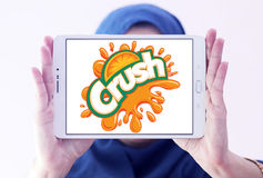 Crush logo. Logo of drinks company crush on samsung tablet holded by arab muslim woman stock images